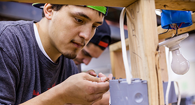 Students of TERO Vocational Training Center working on an electrical project.
