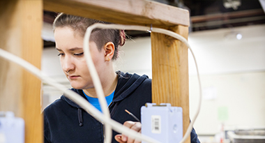 Student of TERO Vocational Training Center working on an electrical project.